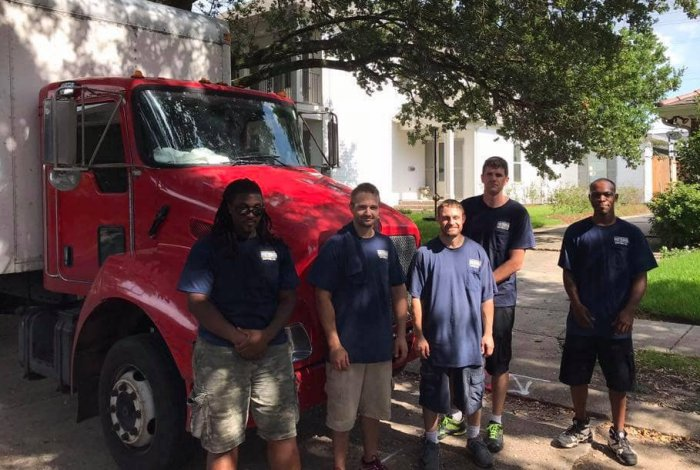 new orleans movers standing in front of a local moving truck